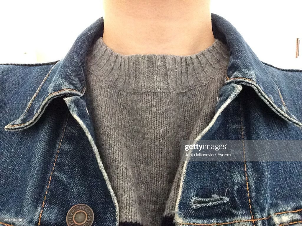 Midsection Of Man In Denim Jacket : Stock Photo
