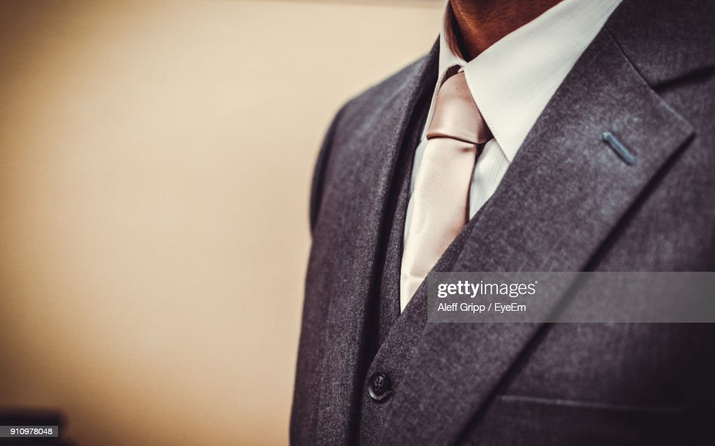 Midsection Of Man In Suit : Stock Photo