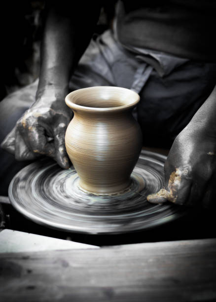 Midsection Of Man Making Pot In Workshop