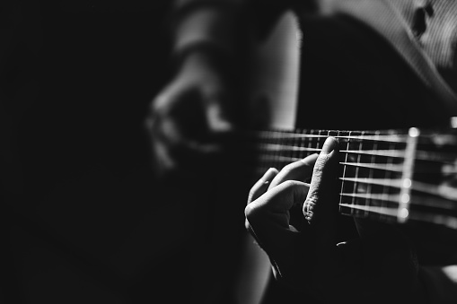 Midsection Of Man Playing A Guitar, black And White 1129490620
