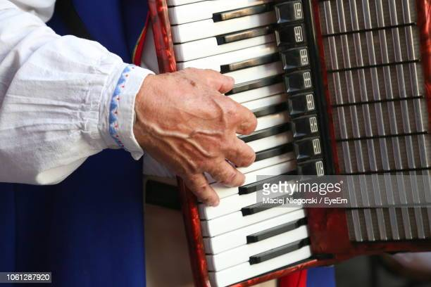 midsection of man playing accordion - accordion instrument stock pictures, royalty-free photos & images