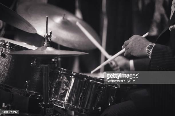 Midsection Of Man Playing Drum Kit