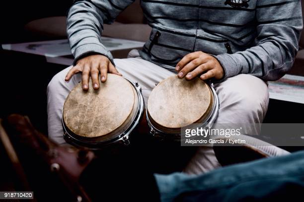 midsection of man playing drum - percussion instrument stock photos and pictures