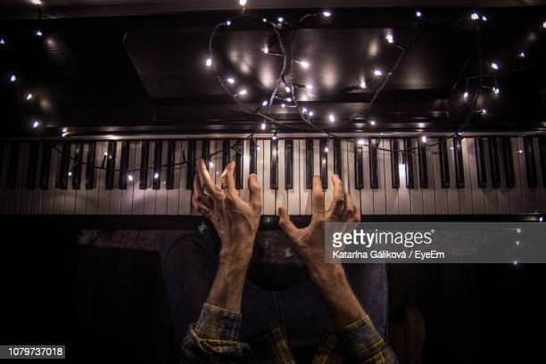 midsection of man playing piano - pianist front stock pictures, royalty-free photos & images