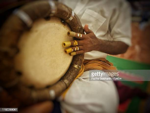 midsection of man playing tabla during traditional ceremony - tamil nadu stock pictures, royalty-free photos & images