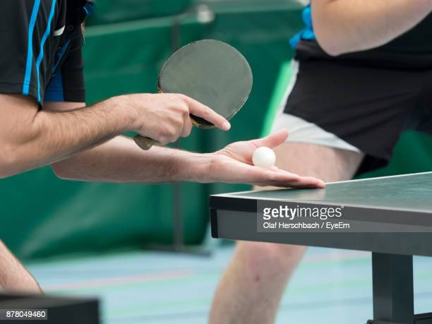 Midsection Of Man Playing Table Tennis