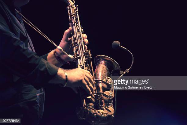 midsection of man playing trumpet - jazz stock pictures, royalty-free photos & images