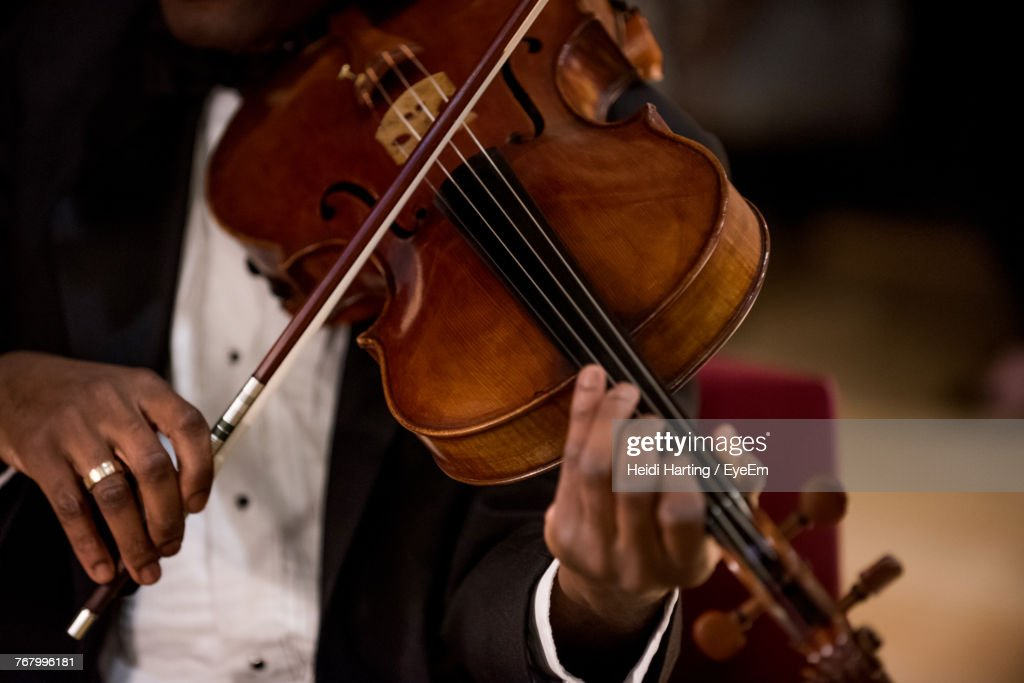 Midsection Of Man Playing Violin : Stock Photo