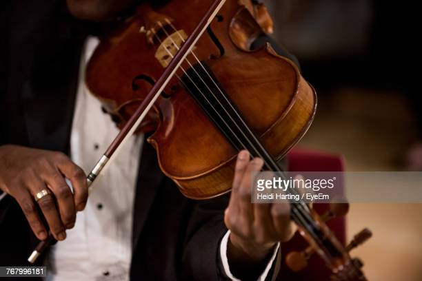 midsection of man playing violin - stringed instrument stock pictures, royalty-free photos & images