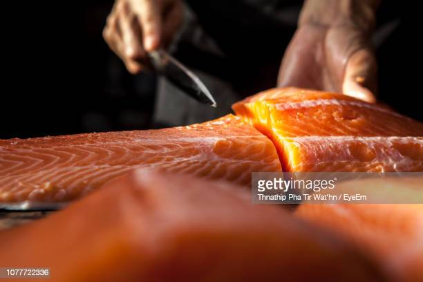midsection of man preparing food in commercial kitchen - salmon seafood stock pictures, royalty-free photos & images
