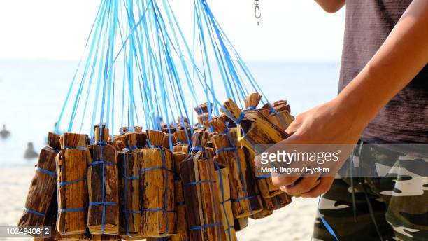 midsection of man selling food at beach - mark's stock pictures, royalty-free photos & images