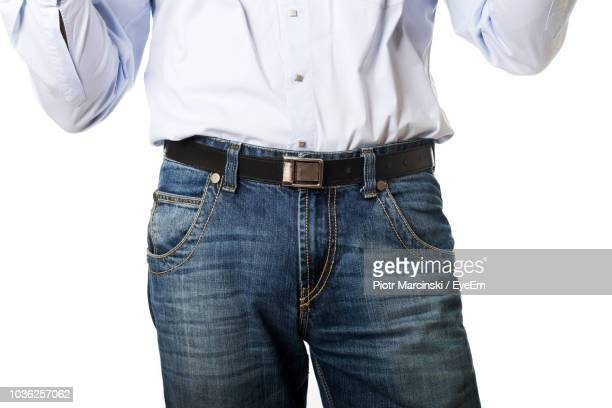 Midsection Of Man Standing Against White Background