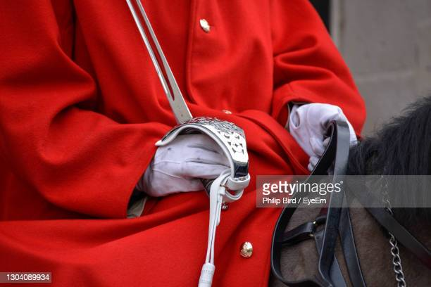 midsection of man standing outdoors - queen royal person stock pictures, royalty-free photos & images