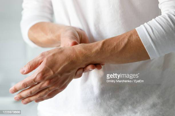 midsection of man standing - rheumatism stock pictures, royalty-free photos & images