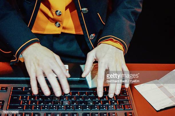 Midsection Of Man Using Keyboard