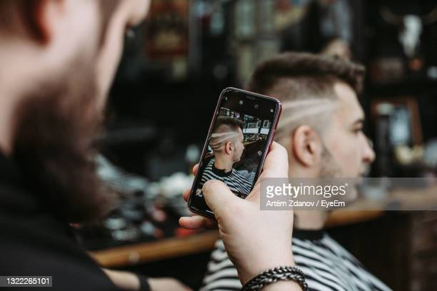 midsection of man using mobile phone outdoors - ニジニ・ノヴゴロド州 ストックフォトと画像