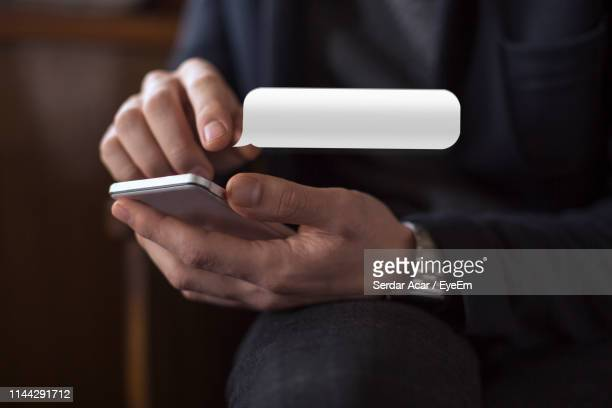 midsection of man using mobile phone - text stock pictures, royalty-free photos & images