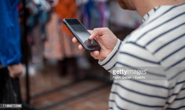 midsection of man using mobile phone - florin seitan stock pictures, royalty-free photos & images