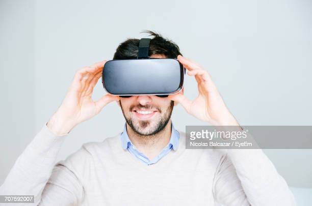Midsection Of Man Using Virtual Reality Simulator
