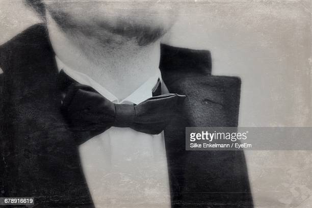 Midsection Of Man Wearing Bow Tie