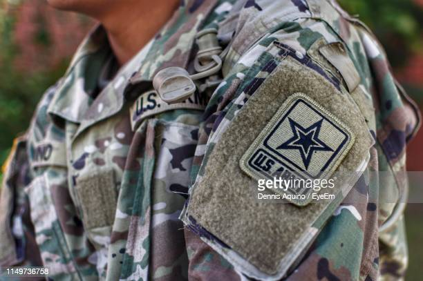 midsection of man wearing military uniform - 米軍 ストックフォトと画像