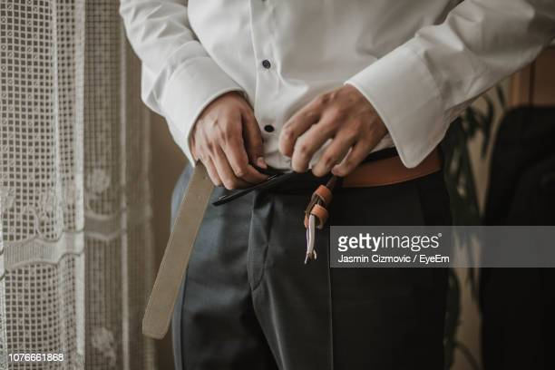 midsection of man wearing pants - hands in her pants stock pictures, royalty-free photos & images