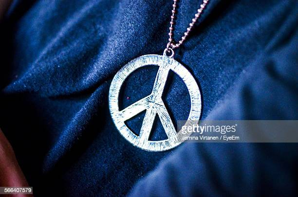 Midsection Of Man Wearing Peace Sign Necklace