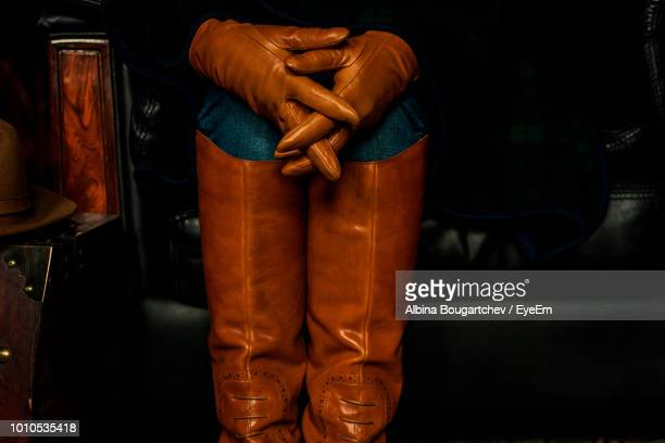 midsection of man wearing protective clothing while standing in darkroom - leather glove stock pictures, royalty-free photos & images