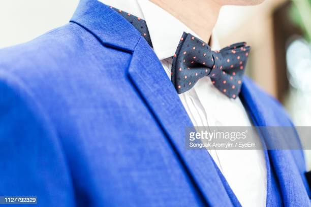 midsection of man wearing suit - bow tie stock pictures, royalty-free photos & images