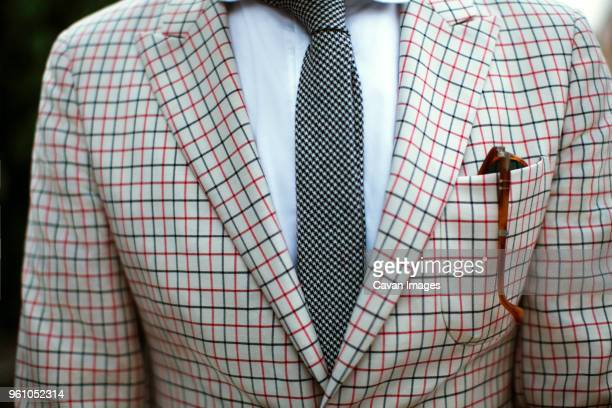 midsection of man wearing suit - checked suit stock pictures, royalty-free photos & images