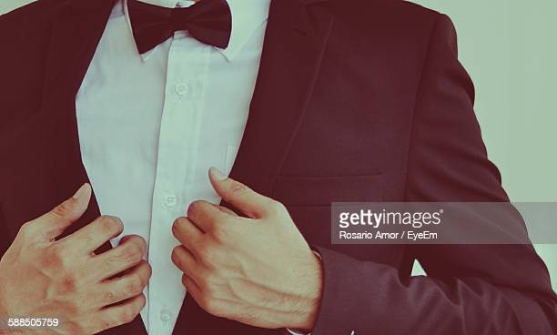 Midsection Of Man Wearing Tuxedo