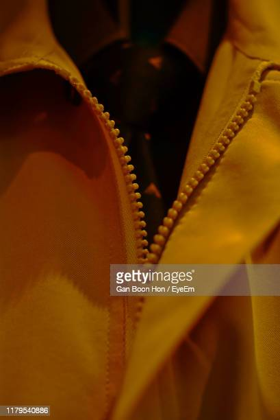 midsection of man wearing yellow jacket - jacket stock pictures, royalty-free photos & images