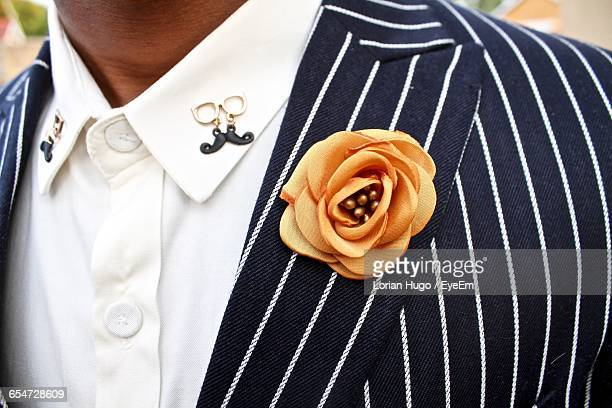 Midsection Of Man With Artificial Flower On Blazer