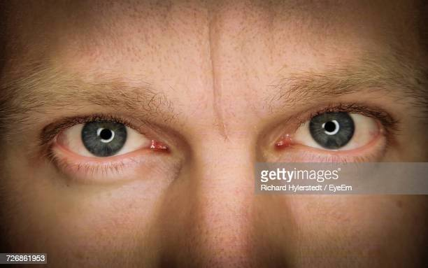 Midsection Of Man With Gray Eyes