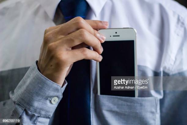 Midsection Of Man With Mobile Phone