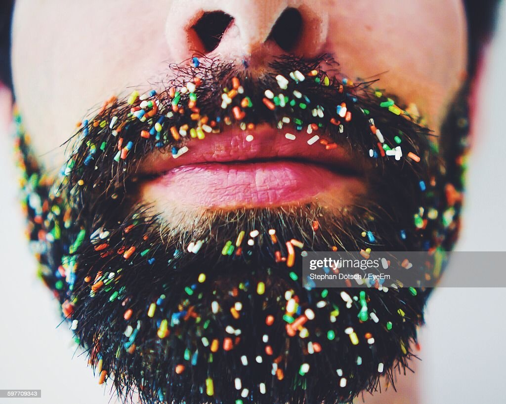 Midsection Of Man With Sprinkles On Beard And Mustache
