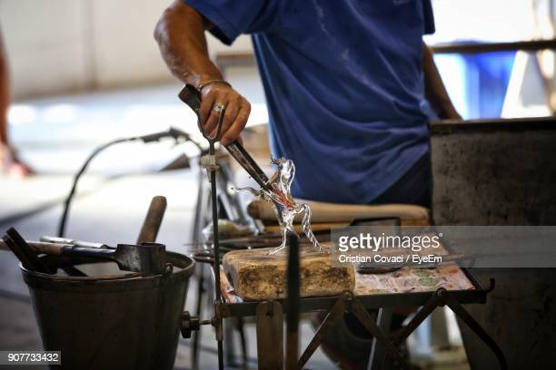 Midsection Of Man Working At Workshop