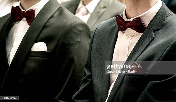 Midsection Of Men In Suit During Wedding