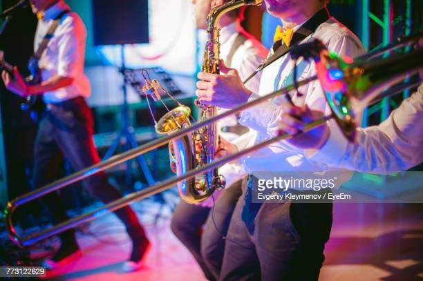midsection of men playing trumpet - jazz stock pictures, royalty-free photos & images