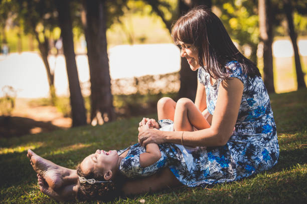 Midsection Of Mother And Daughter Outdoors