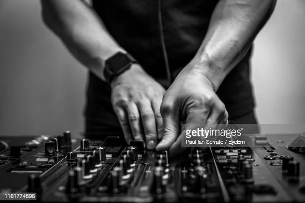 midsection of musician adjusting sound mixer - equaliser stock pictures, royalty-free photos & images