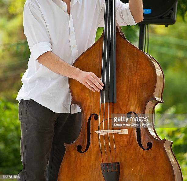 Midsection Of Musician Playing Cello