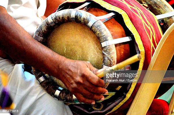 midsection of musician playing drum at wedding ceremony - indian music stock photos and pictures