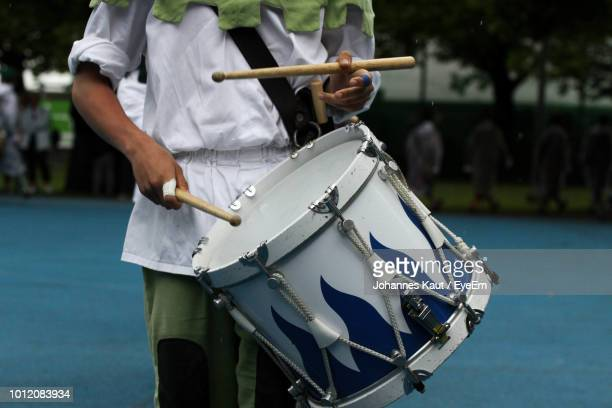 midsection of musician playing drum - percussion instrument stock photos and pictures