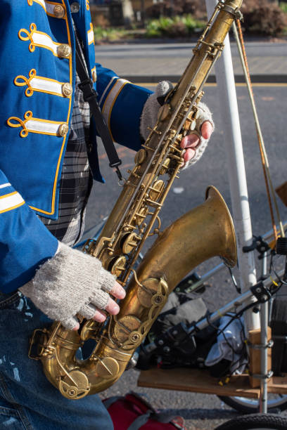 Midsection Of Musician Playing Saxophone On Road
