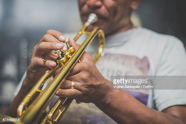 Midsection Of Musician Playing Trumpet