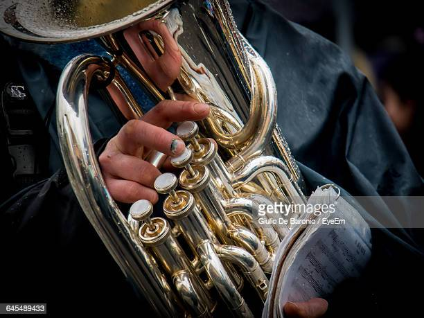 Midsection Of Musician Playing Tuba During Carnival