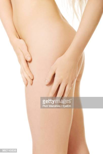 Midsection Of Naked Woman Against White Background