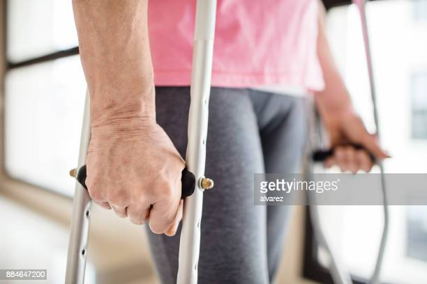 midsection of patient with crutches in hospital - crutch stock photos and pictures