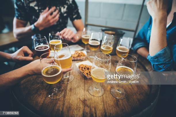 Midsection Of People Drinking Beer